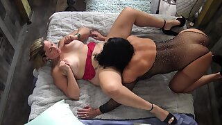 Busty MILFs licking and toying each others wet pussies