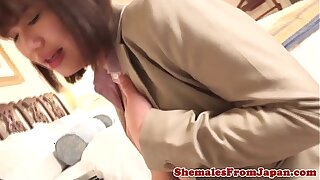 Japanese office tranny drops her cumload